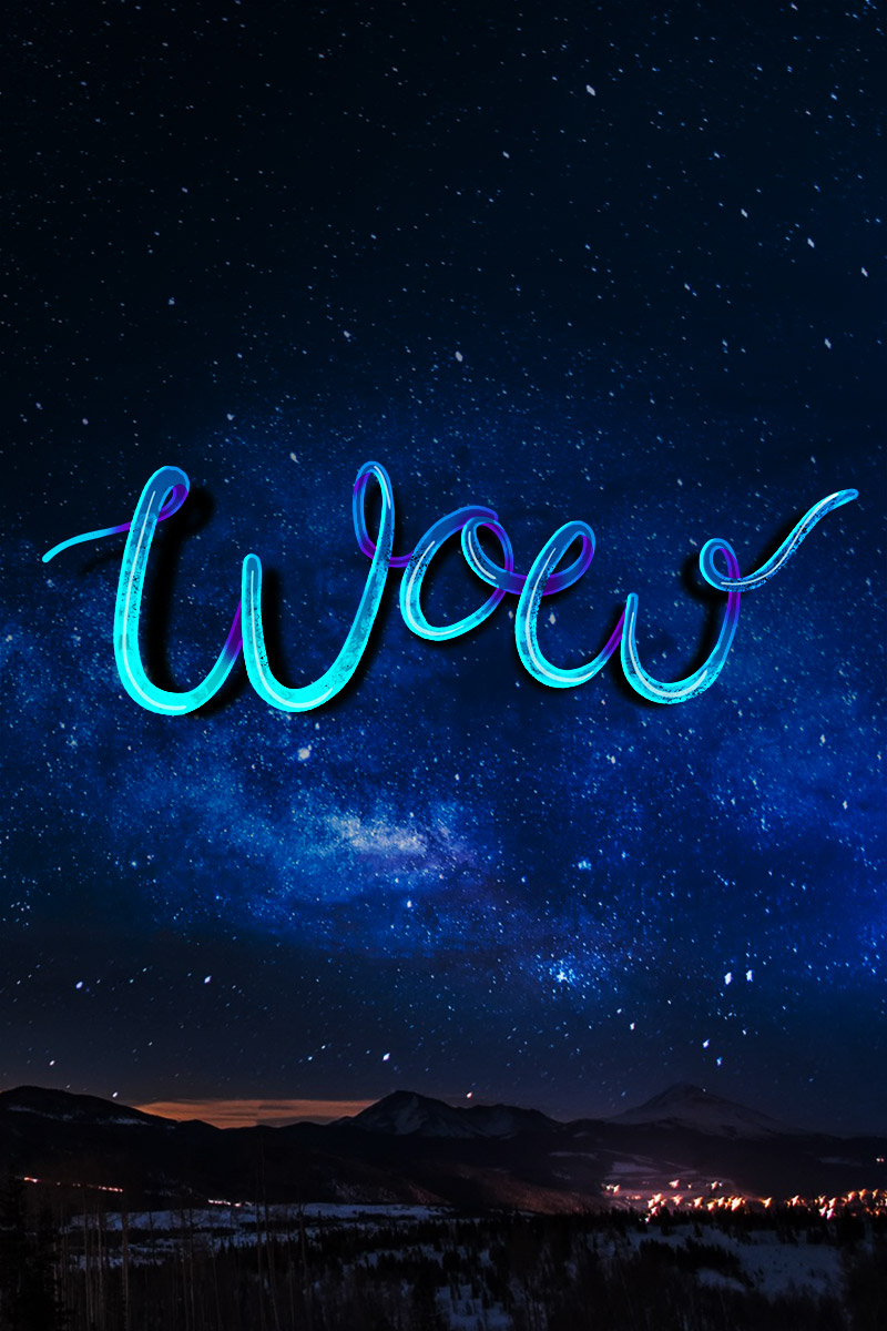Typography - 'Wow' in the starry night sky over a snowy / landscape